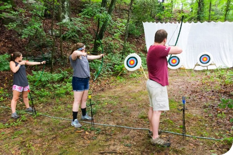 Lutheranch summer campers doing archery