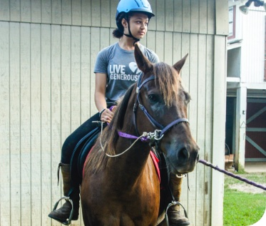 Lutheranch female camper riding a horse