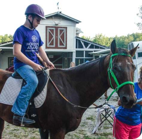 Lutheranch male camper riding a horse